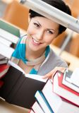 Reading book pretty female student Stock Images