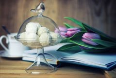 Reading book with tea flower and sweet Royalty Free Stock Photography