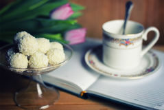 Reading book with tea flower and sweet Royalty Free Stock Image