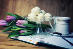Reading book with tea flower and sweet Stock Photo
