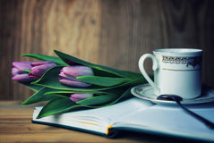 Reading book with tea flower and sweet Royalty Free Stock Images