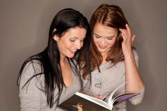 Reading a book together Royalty Free Stock Images