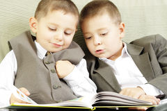 Reading book together Stock Photos