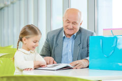 Reading a book together. Stock Photography