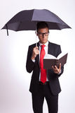 Reading a book under the umbrella Royalty Free Stock Photo
