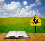 Reading book for understand traffic sign Royalty Free Stock Images
