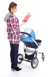 Reading book young mother with baby pram. Reading book young mother with baby stroller, white background Stock Photography