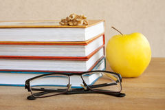 Reading. Books, Glasses and Apple Stock Photo
