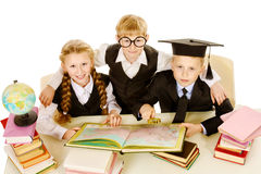 Reading books. Schoolchildren reading books together. Isolated over white stock photos