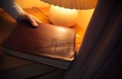 Reading books before sleaping. Horizontal image stock photo