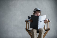 Reading boy. Little boy with a screenplay Royalty Free Stock Photography