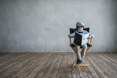 Reading boy. Little boy with screenplay indoors Stock Images