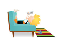 Reading boy on a sofa Stock Photo