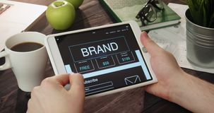 Reading brand info using digital tablet stock video