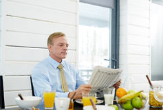 Reading after breakfast Royalty Free Stock Image