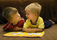 Reading brothers. Siblings reading a book together, enjoying each other's company Stock Photography