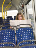 Reading on the bus Stock Image