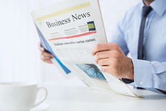 Reading Business News Stock Image