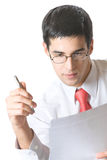 Reading businessman with pen Royalty Free Stock Images