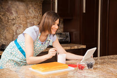 Reading a cake recipe online Stock Images