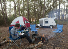 Reading and camping Royalty Free Stock Images