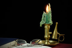 Reading by candle light Stock Photography