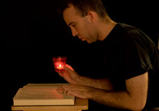Reading By Candlelight Stock Images