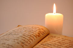 Reading by the Candlelight Royalty Free Stock Photo
