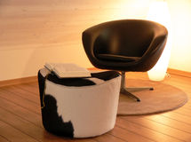Reading Chair. A reading chair and a cow stool with a bestselling book on top Royalty Free Stock Photography