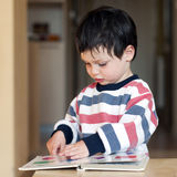 Reading child Stock Image