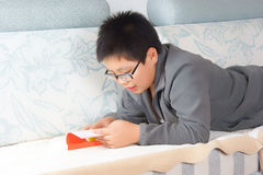 Reading Chinese boy Royalty Free Stock Photography