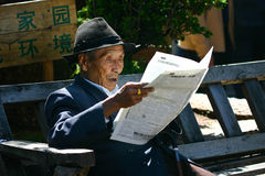 Reading Chinese newspaper Stock Images