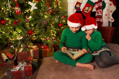 Reading christmas stories Stock Photos