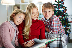 Reading Christmas tales Royalty Free Stock Photo