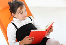 Reading Classroom - girl reading a book Royalty Free Stock Photos