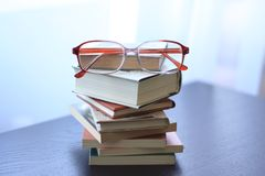Reading concept books and glasses Stock Photo
