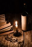 Reading concept - pile of old books and glasses Royalty Free Stock Photo