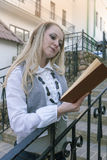 Reading Concepts and Ideas. Portrait of Sensual Caucasian Blond Woman Reading Book Outdoors in City Royalty Free Stock Images