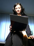 Reading the contract. Business woman sitting on her desk and reading a contract stock photography