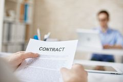 Reading contract Stock Image