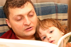 Reading with dad Stock Images
