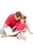 Reading with dad Royalty Free Stock Photos
