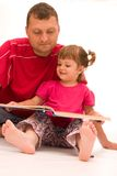 Reading with dad Royalty Free Stock Images