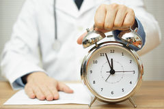 After reading diagnose, doctor is showing clock to patient to ma Stock Photos