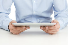 Reading at digital tablet Stock Image