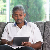 Reading on digital tablet computer Royalty Free Stock Photo