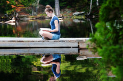 Reading on a dock Royalty Free Stock Image