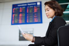 Reading document at the airport Stock Image
