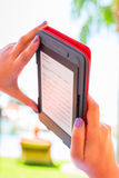 Reading on e-book on summer holidays. Reading on electronic book on summer holidays Royalty Free Stock Images