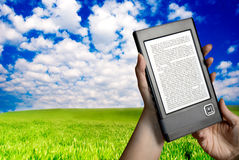 Reading ebook in nature Stock Photos